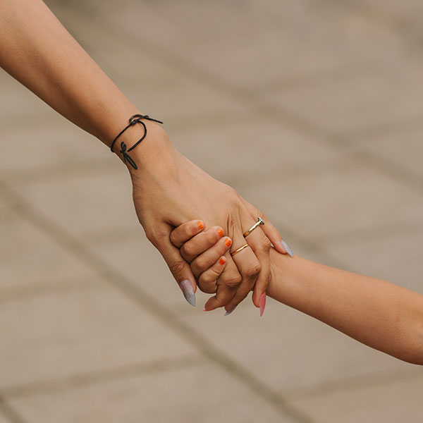 Image: Holding hands.
